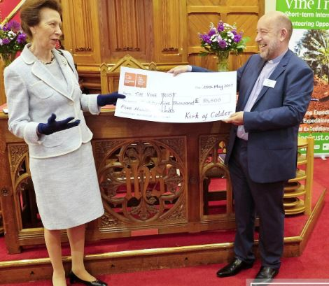 HRH the Princes Royal receives a cheque for £85,000 from the Rev John Povey